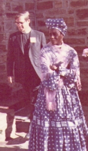 Herero fashions in 1969: Magdalena Bahuurua (housekeeper to Biship Mize) outside St George's Anglican cathedral in Windhoek (the priest in the picture is George Pierce).
