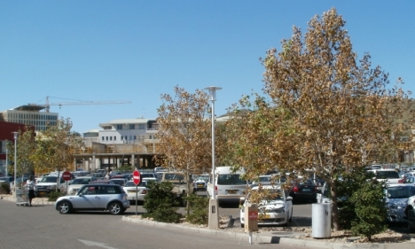A Windhoek shopping mall sdeen from across the car park of another. It was all over builders doing additions to it.