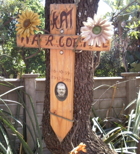 "A memorial near the corner of Owen Avenue and Matterson Street, to N.A.R. Coetzee, known as ""Kat"". Persumably he died in a road accident nearby, though that seems a bit strange in our quiet little cul-de-sac, which gets very little traffic."
