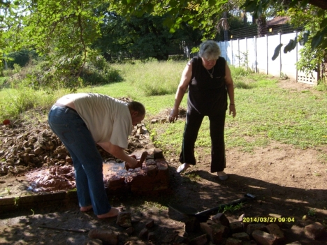 Laying the first bricks for the raised kitchen garden.