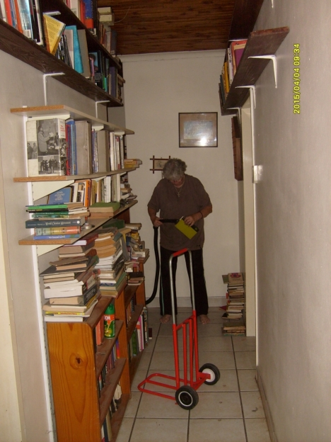 Reshelbing the books in the passage to fit in more shelves