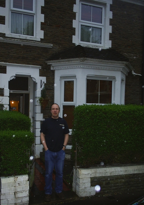 My cousin Simon Hayes outside his house in Cardiff. 6 May 2005