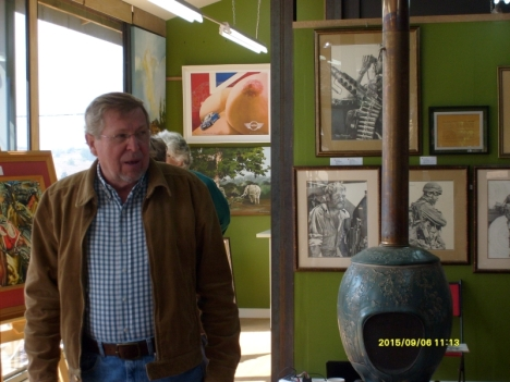 Peter Badcock Walters with the exhibition of his art in the Gallery on the Square, in Clarens.