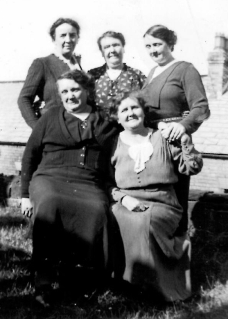 Mattie Pearson and her sisters when she visited the UK in 1939, bust before WW2. Mattie is on the front right. Behind her at the back right is Maggie. Bessie was at the top left. We think the other two are Belle and Lizzie -- can anyone identify them?
